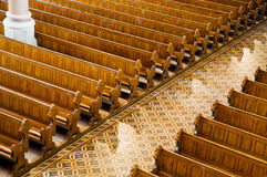 Rows of benches. In a church Royalty Free Stock Images