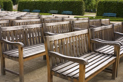 Rows of benches. Rows of worn out wooden benches Royalty Free Stock Photo