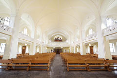 Rows of benches and organ in Evangelical Lutheran Cathedral Stock Images