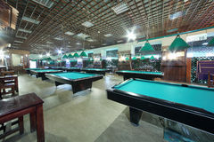 Rows of billiard tables inside club with fences Royalty Free Stock Image