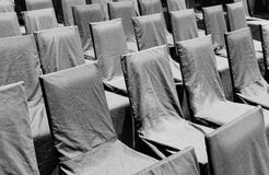 Rows of black chairs. On an outdoor area Royalty Free Stock Photos
