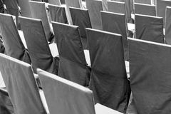 Rows of black chairs. On an outdoor area Royalty Free Stock Images