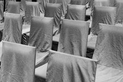 Rows of black chairs. On an outdoor area Stock Image