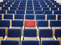 Rows Of Blue Armchairs And One Red Stock Images