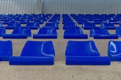 Rows of blue chairs on the podium of the sports hall. Image of rows of blue chairs on the podium of the sports hall Stock Photo