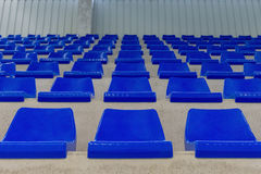 Rows of blue chairs on the podium of the sports hall. Image of rows of blue chairs on the podium of the sports hall Royalty Free Stock Photos