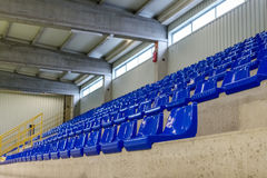 Rows of blue chairs on the podium of the sports hall. Image of rows of blue chairs on the podium of the sports hall Stock Photos
