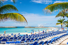 Rows of blue chairs on sea beach with white sand Stock Photography