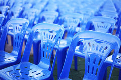 Rows of blue color chairs. In an event field Royalty Free Stock Image