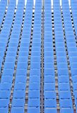 Rows of blue plastic chairs. With no occupants Royalty Free Stock Image