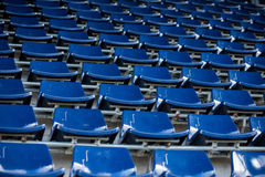 Rows of blue plastic stadium seats. Background of empty seats in a stadium Stock Photos