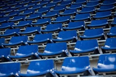 Rows of blue plastic stadium seats. Background of empty seats in a stadium Stock Photography