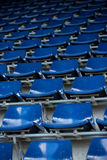 Rows of blue plastic stadium seats. Background of empty seats in a stadium Royalty Free Stock Photo