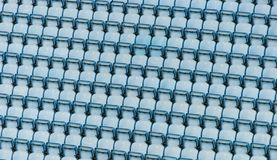 Rows of blue plastic stadium seats. Rows of blue plastic stadium seats, with no audience Royalty Free Stock Image