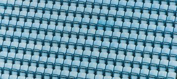 Rows of blue plastic stadium seats. Rows of blue plastic stadium seats, with no audience Royalty Free Stock Photo