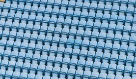 Rows of blue plastic stadium seats. Rows of blue plastic stadium seats, with no audience Stock Images