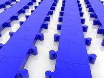 Rows of blue puzzle. In backgrounds Royalty Free Stock Images