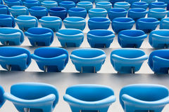Rows of blue seats at football stadium. Convenient sitting for all.  Royalty Free Stock Photo