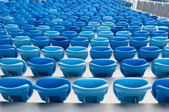 Rows of blue seats at football stadium. Convenient sitting for all.  Stock Photo