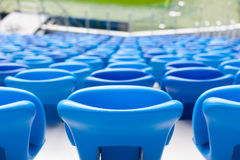 Rows of blue seats at football stadium. Convenient sitting for all.  Stock Photography