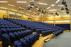 Rows of blue seats in a lecture theatre Stock Images