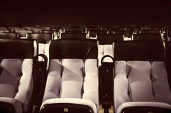 Rows of blue seats. Rows of seats greyish blue color in a cinema theater. Duo tone color image Close up and selective focus of Empty rows of armchairs in hall Stock Photography