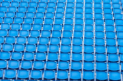 Rows of blue seats in a stadium Royalty Free Stock Photo