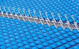Rows of blue seats in a stadium Stock Photo