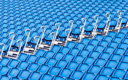 Rows of blue seats in a stadium. Or sports venue Royalty Free Stock Photos