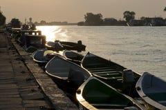 rows of boats at docks Stock Photo