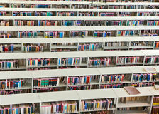 Rows of books in a public library Royalty Free Stock Image