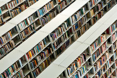 Rows of books in a public library stock photo