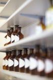 Rows of bottles in pharmacy Stock Photos