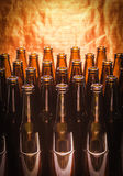 Rows of brown color empty bottles beer Stock Image