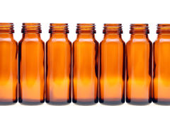 Rows of brown glass bottles Stock Images