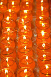 Rows of buddhish blessing candle offerings Royalty Free Stock Image