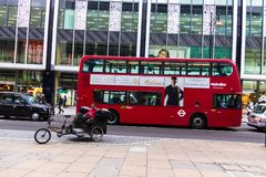 Rows of buses and taxis drive along Oxford Street in London. Oxford Street is one of London`e busiest streets. stock photos