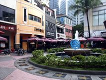 Rows of cafes and restaurants as well as site attractions at the Eastwood City Stock Photos