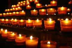 Rows of candles. In church stock images