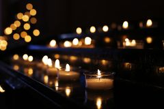 Rows of candles in a church stock photos