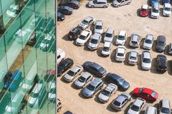 Rows of cars parked near an office building. Aerial view. BUCHAREST, Romania - September 15 2016: Rows of cars parked near an office building. Aerial view Stock Image