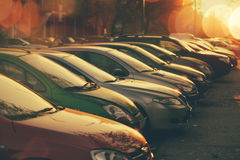 Rows of cars parked in residential district Stock Photo
