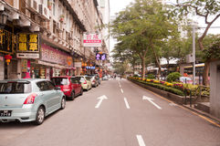 Rows of cars parking at roadside in Macao royalty free stock image