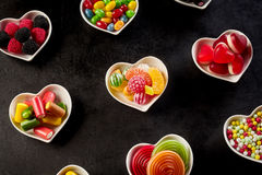 Rows of ceramic heart shaped bowls with candies Royalty Free Stock Photos