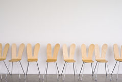 Rows of chair infront of wall. Royalty Free Stock Photography