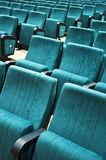Rows of chairs in auditorium. A picture of rows of green chairs in an empty auditorium Royalty Free Stock Photo