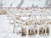 Rows of chairs in empty outdoor restaurant Stock Image