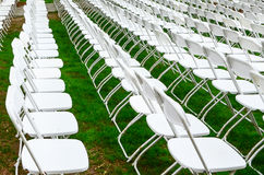 Rows of chairs form a beautiful pattern on the grass land Stock Images
