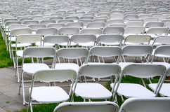 Rows of chairs form a beautiful pattern on the grass land Stock Image
