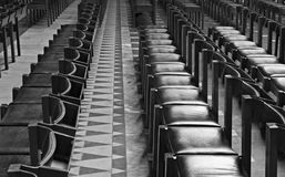 Rows of chairs inside Cathedral Stock Photography